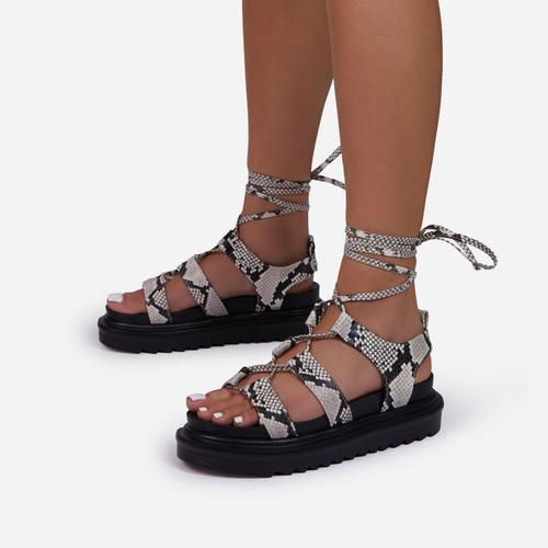 Don't-Hate Lace Up Chunky Sole Caged Flat Gladiator Sandal In Nude Snake Print Faux Leather