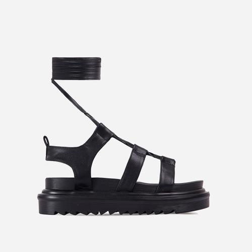 Don't-Hate Lace Up Chunky Sole Caged Flat Gladiator Sandal In Black Faux Leather