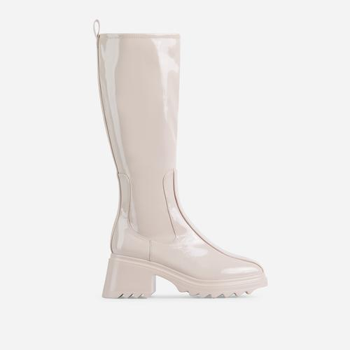 Burst Block Heel Knee High Long Wellington Boot In Nude Patent