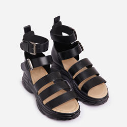 Cristiano Chunky Sole Flat Gladiator Sandal In Black Faux Leather