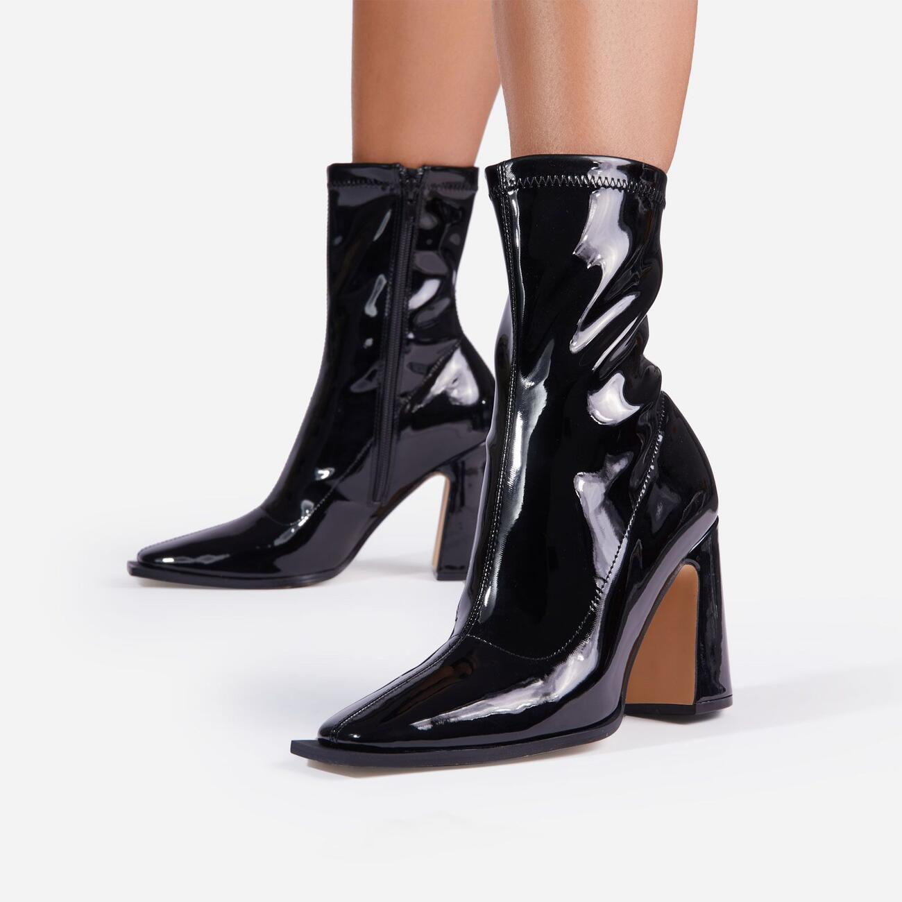 Nessie Flared Block Heel Ankle Sock Boots In Black Patent