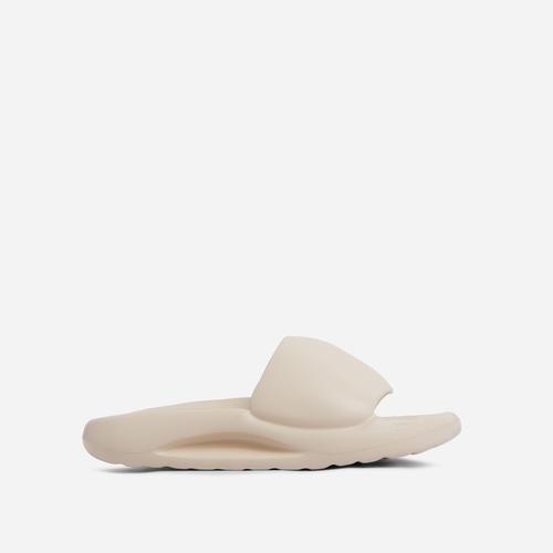 Supergirl Flat Slider Sandal In Off White Rubber