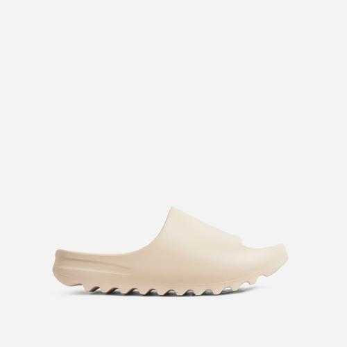 Playoff Flat Slider Sandal In Off White Rubber