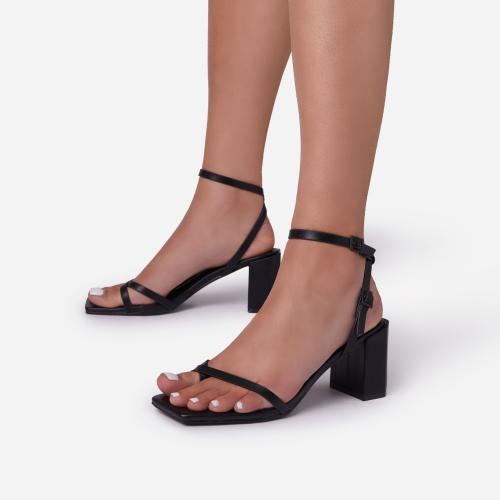 Amal Toe Post Strap Barely There Square Toe Low Block  Heel In Black Faux Leather