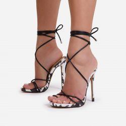 Gelato Lace Up Platform Heel In Black Cow Print Faux Suede
